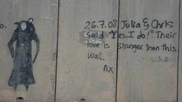 """Love is stronger than this wall."" - Ar Ram, West-Bank side of Separation Wall, near Qalandiya Checkpoint - 6 Jan. 2011 - Photo: Sherry Ann"